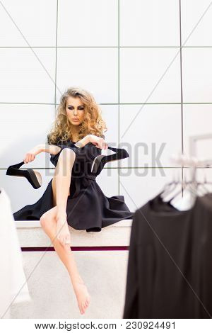 Fashion Model With Black High Heel Shoes In Dressing Room. Sensual Woman With Makeup Face, Long Hair