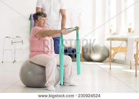 Elderly Woman Sitting On Ball