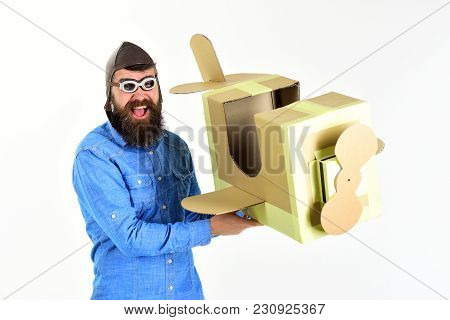 Bearded Man Father Hold Cardboard Plane Isolated On White. Bearded Man Pilot Or Father With Plane