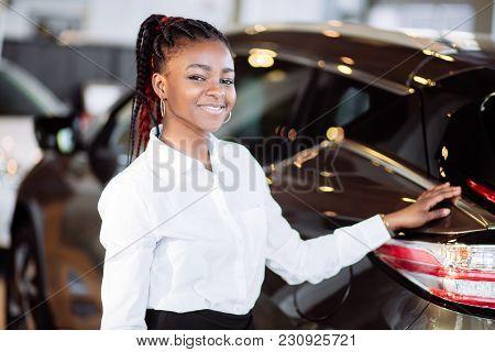 Car Dealer Woman. Auto Dealership And Rental Concept Background.