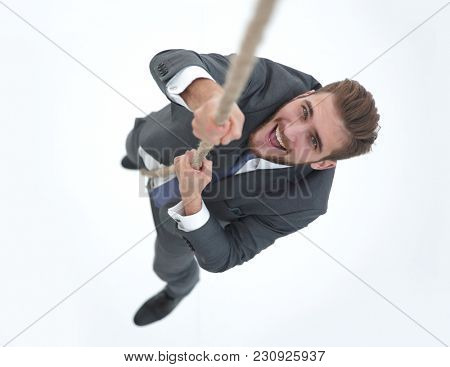 successful businessman climbing the rope