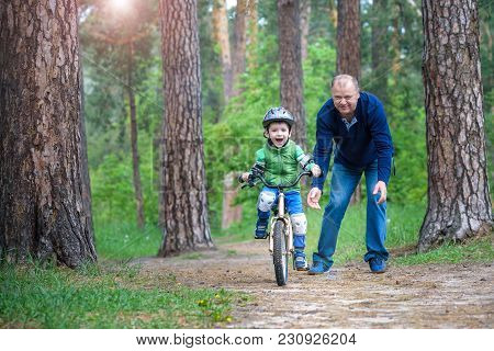 Little Kid Boy Of 3 Years And His Father In Autumn Forest With A