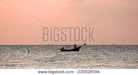 Lonely Fisherman's Boat At Sunrise