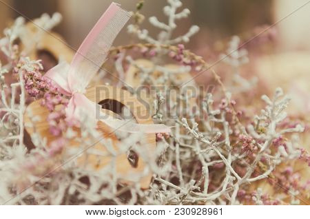 Soft Tender Pastel Pink Background With Wooden Heart And Plants With Copy Space. Can Be Used Like A