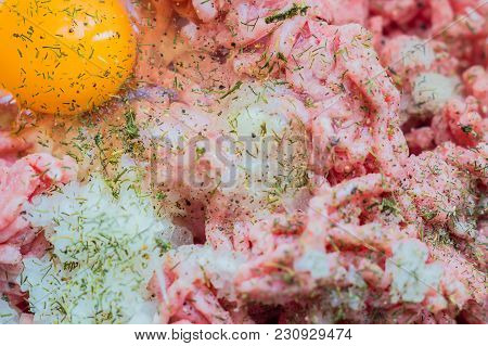 Minced Meat In A Bowl With Raw Egg, Spices And Chopped Onion For Cooking Cutlets, Selective Focus