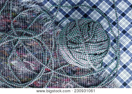 Ball Of Colored Rope On Cloth Background