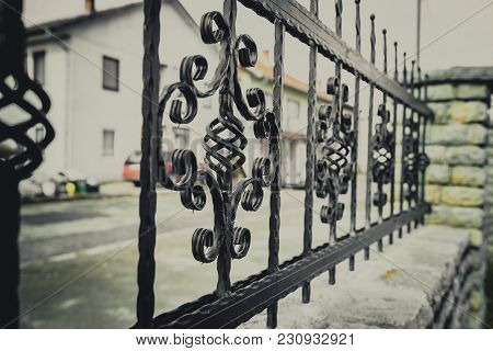 Wrought Iron And Cut Stone Fence, Fence With Ornaments