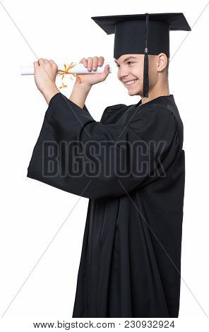 Portrait Of Graduate Teen Boy Student In Black Graduation Gown With Hat, Holding Diploma - Isolated