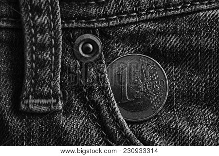 Monochrome Euro Coin With A Denomination Of One Euro In The Pocket Of Light Blue Denim Jeans.