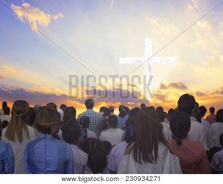 Religious Cross Silhouette Against A Bight Sunrise Sky