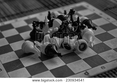 Monochrome Wooden Chess Board And Magnetic Plastic Chess Pieces, On Board.