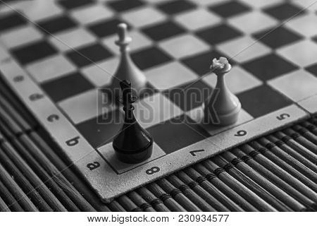 Monochrome Wooden Chess Board And Steel Chess Pieces, Isolated On Board.