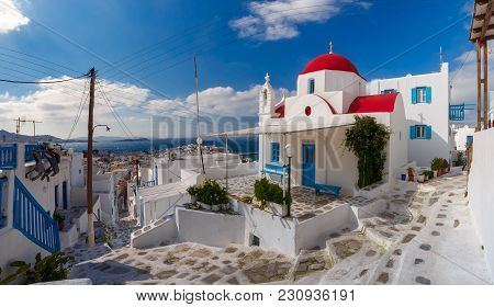Panoramic View With Traditional Church With Red Dome And Whitewashed Facade, Typical Greek Church Bu