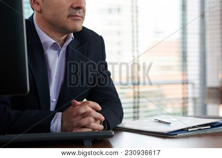Cropped Image Of Business Executive Sitting At His Table