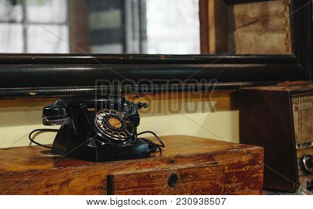 Still Life Of Old Vintage Retro Black Telephone On Asia Style Wood Table In Vintage Retro Room