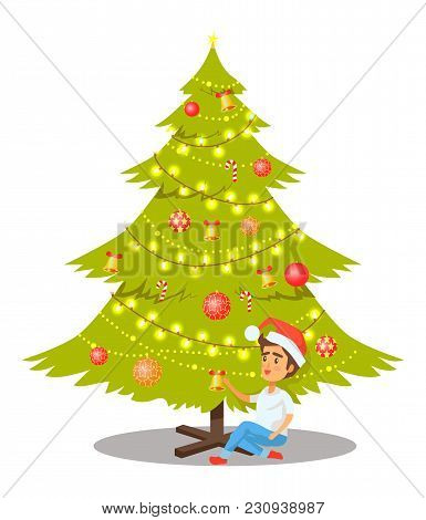 Christmas Tree Decorated With Glittering Garlands, Balls With Stars And Bells With Bows, Sweet Tradi