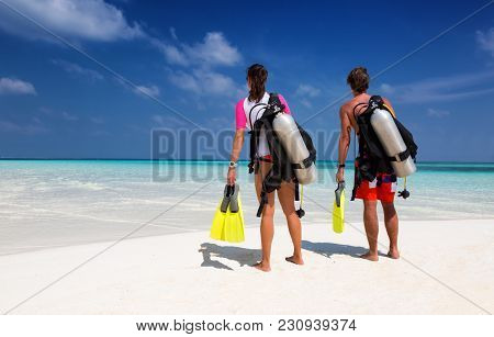 Young Couple In Scuba Diving Gear On A Tropical Beach