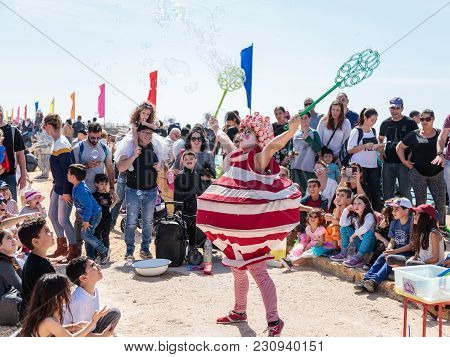 Caesarea, Israel, March 03, 2018 : A Participant Of The Purim Festival Dressed In Fabulous Costume,