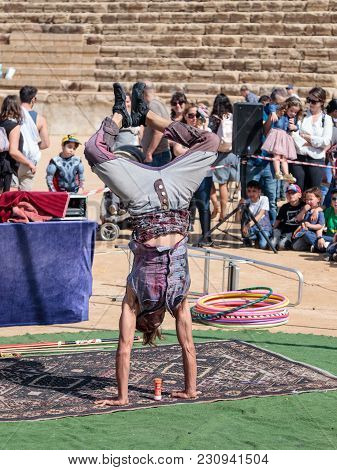 Caesarea, Israel, March 03, 2018 : A Participant Of The Purim Festival Shows A Performance For Visit