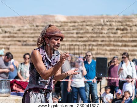 Caesarea, Israel, March 03, 2018 : A Participant Of The Purim Festival Dressed As A Statue Sitting I