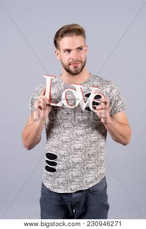 Bachelor With Serious Face Hold Wooden Love Word, Design. Valentines Day Concept. Love, Romance, Pro