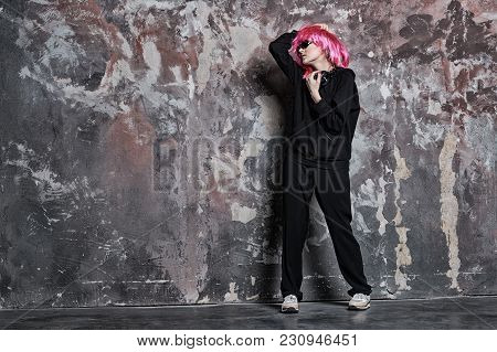 Girl With Sunglasses, Headphones On Abstract Wall, Vintage Filter. Woman In Pink Wig Hair, Sport Sui