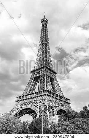 Eiffel Tower At Sunset In Paris, France. Romantic Travel Background. Eiffel Tower Is Traditional Sym