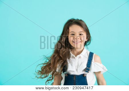 Haircare, Hairstyle, Hairdresser, Barber. Girl Smile With Flowing Long Wavy Hair On Blue Background.