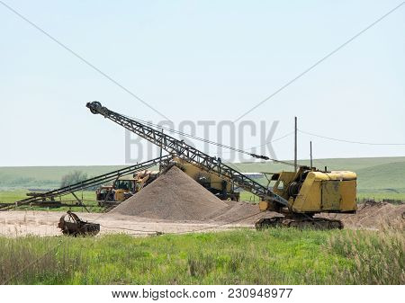 Old Excavator Working In A Small Quarry