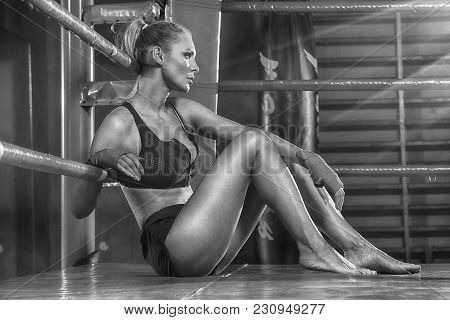 Female Boxer Posing Inside A Boxing Ring.