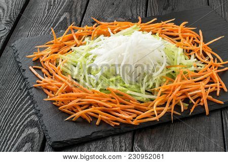 Ingredients For Preparation Of Vitamin Salad. Straw Of Carrot, Daikon, Green Radish On Slate Board.