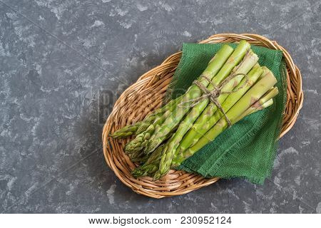 Fresh Green Asparagus On Green Linen Cloth In Basket. Bunch Of Raw Asparagus Sprouts. Healthy Food,