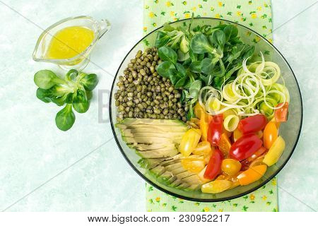 Vegetarian Lunch Bowl With Beans Mung, Avocado, Leek, Cherry Tomatoes, Corn Lettuce On Light Green B