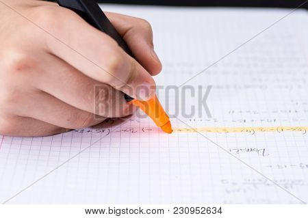 Highlighter In Childrens Hand Marked Text In Notebook. School Concept.