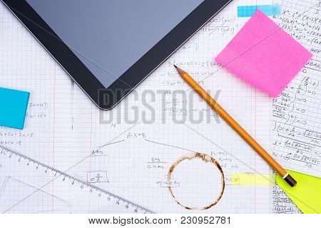 Digital Tablet, Pencil, Ruler Over Sheet Of Paper With Mathematical Formulas. School, Education And