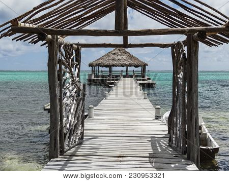 Looking Down A Long Dock On The Beach In San Pedro Belize Central America