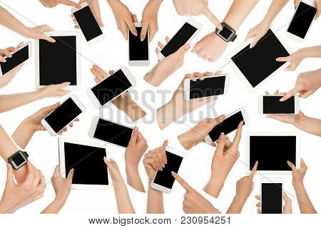 Set Of White Male And Female Hands Touching Mobile Phone And Tablet Display And Pointing With Index