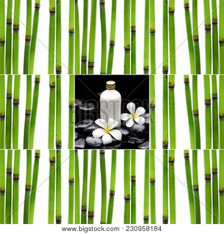 Spa Composition With Zen Stones and bamboo grove steam ,bottle, oil, frangipani,