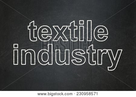 Manufacuring Concept: Text Textile Industry On Black Chalkboard Background