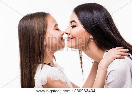 Portrait Of Happy Mother And Daughter Isolated On White Background. Daughter Kissing Mother. Happy F