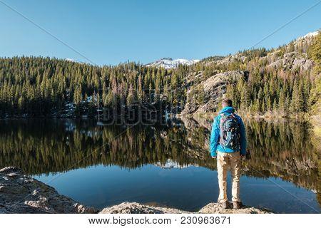 Tourist near Bear Lake at autumn in Rocky Mountain National Park. Colorado, USA.