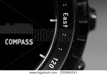 Detail Closeup Of Black Wristwatch With Compass