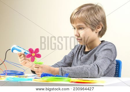 Kid With 3d Printing Pen Creating A Flower.