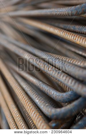 Pile Of Rusty Curved Construction Steel Rods