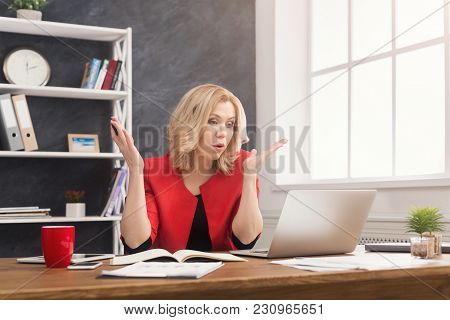Emotional Businesswoman Working On Laptop At Office. Businesswoman Working On Computer And Writing N