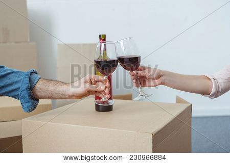 Cropped Shot Of Couple Holding Glasses Of Wine And Celebrating Relocation