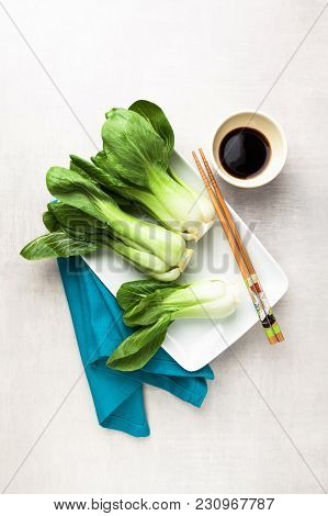 Fresh Not Cooked Bok Choy And Soy Sauce On The Table. Chinese Chopsticks. Asian Cuisines Ingredient