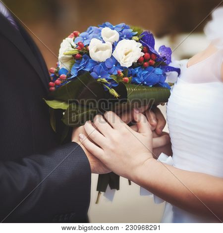 Lovers Are The Groom And The Bride, In Whose Hands The Wedding Bouquet Is Symbolized By Their Love A
