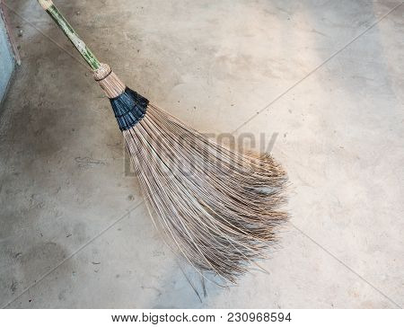 Clouseup Of The Coconut Leaf Stick Broom For Sweeping In The Construction House.