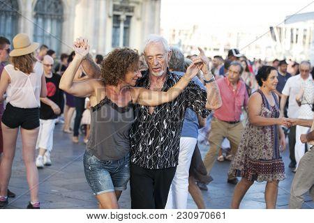 Barcelona, Spain - August 16, 2016: Senior Couple Dancing On The Streets Of Barcelona Near Port Vell